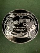 A 'FORD MOTOR COMPANY' BLACK AND SILVER METAL SIGN (D: 49.5CM)