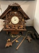 A VERY LARGE EXAMPLE OF A WOODEN HEAVILY CARVED CUCKOO CLOCK TO INCLUDE WEIGHTS (APPROXIMATELY
