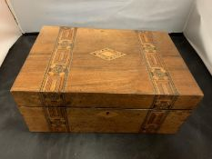 AN INLAID WOODEN HINGED BOX TO INCLUDE THE SEWING PARAPHERNALIA CONTENTS