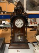 A VERY LARGE ORNATE CARVED MANTEL CLOCK WITH DOG HEAD CAMEO TO TOP - 88CM HIGH (KEY)