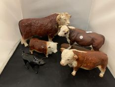FOUR HEREFORD BULL ORNAMENTS TO INCLUDE A FURTHER SMALL BLACK BULL