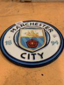 A 'MANCHESTER CITY' CAST METAL PLAQUE