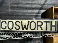 AN ILLUMINATED 'COSWORTH' SIGN