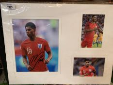 A SIGNED PHOTOGRAPH OF MARCUS RASHFORD MANCHESTER UNITED STAR WITH TWO FURTHER PHOTOGRAPHS IN A