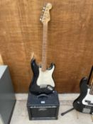 A 'SQUIRE STRAT' ELECTRIC GUITAR AND A PEAVEY AMPLIFIER