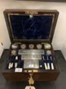 A VICTORIAN LADIES MAHOGANY INLAID MOTHER OF PEARL TRAVELLING VANITY CASE WITH WRITING SLOPE AND TWO