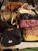 A LARGE QUANTITY OF HANDBAGS AND PURSES