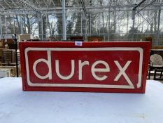 AN ILLUMINATED 'DUREX' SIGN
