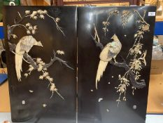 A PAIR OF CHINESE EBONISED WALL PLAQUES DEPICTING MOTHER OF PEARL BIRDS WITH ARTIST'S SIGNED STAMP
