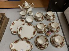 A ROYAL ALBERT 'OLD COUNTRY ROSES' SIX TRIO TEA SET TO INCLUDE A TEAPOT AND CAKE PLATES