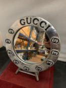 A CIRCULAR CHROME 'GUCCI' TABLE MIRROR D:25CM