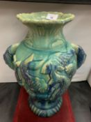 A LARGE TWIN HANDLED PESCATORIAL URN DEPICTING ORIENTAL STYLE CARP H: 40CM (RIM A/F)