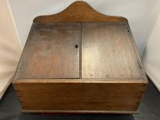 A VINTAGE WOODEN TWO DOOR DESK TOP STATIONARY BOX