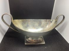 A HALLMARKED SILVER LONDON 1934 TWIN HANDLED BON BON DISH WITH WEIGHTED BASE GROSS WEIGHT