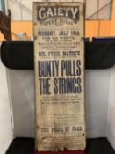A GAIETY THEATRE AND OPERA HOUSE ADVERTISING POSTER ON BOARD FOR ' BUNTY PULLS THE STRINGS' THIS