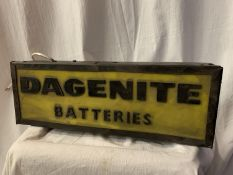 AN ILLUMINATED 'DAGENITE BATTERIES' SIGN