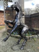 A LARGE METAL SCULPTURE IN THE FORM OF A REARING HORSE H: 125CM