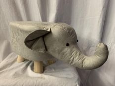 A FAUX LEATHER CHILD'S FOOT STOOL IN THE FORM OF AN ELEPHANT