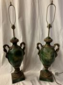 A PAIR OF LARGE GREEN URN SHAPED TABLE LAMPS WITH TWIN HANDLES IN THE FORM OF INTERTWINED SNAKES H: