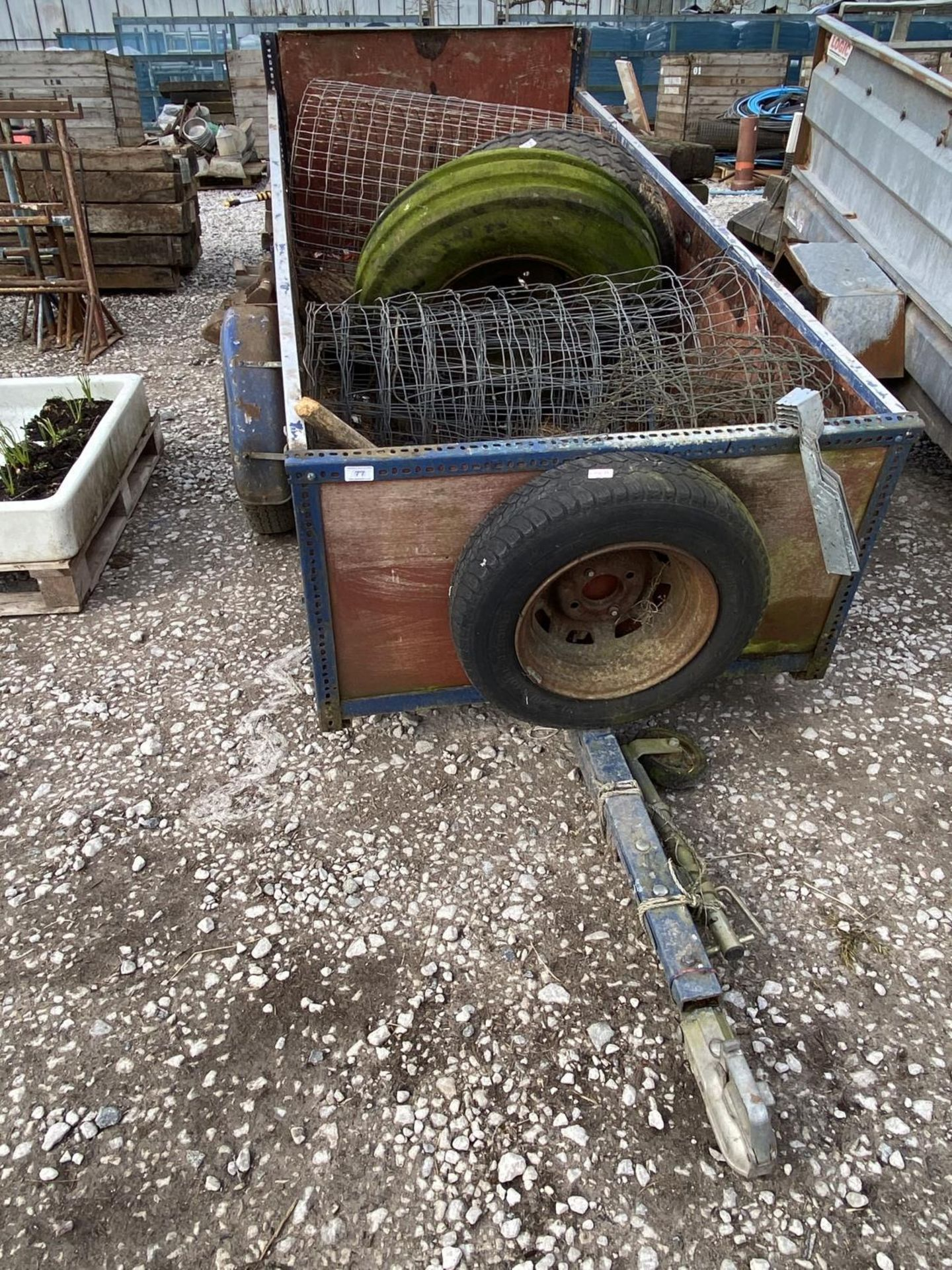 A TWO WHEELED TRAILER AND CONTENTS + VAT