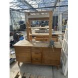 A WORK STATION WITH A RICHMOND VICE AND WOODEN SHELVING UNIT NO VAT