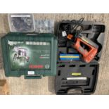 TWO ITEMS TO INCLUDE A BOSCH ROUTER POF 1400 ACE AND TEMPLATES ETC AND A TACWISE MASTER NAILER NO