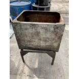A GALVANISED WATER TANK ON A STAND NO VAT