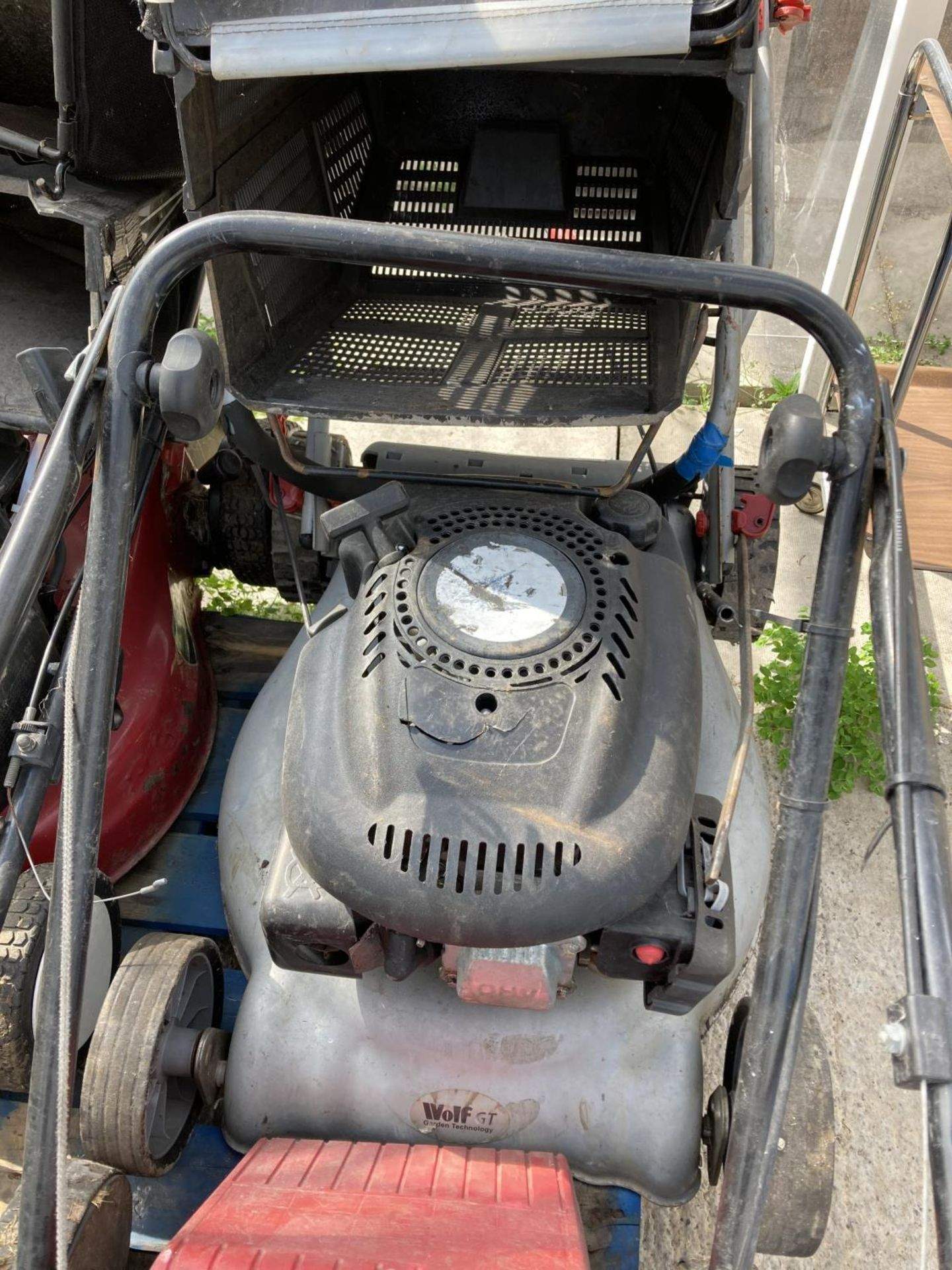 FOUR LAWNMOWERS TO INCLUDE TWO MOUTFIELD, A TESCO AND A WOLF GT 20SP + VAT - Image 4 of 5