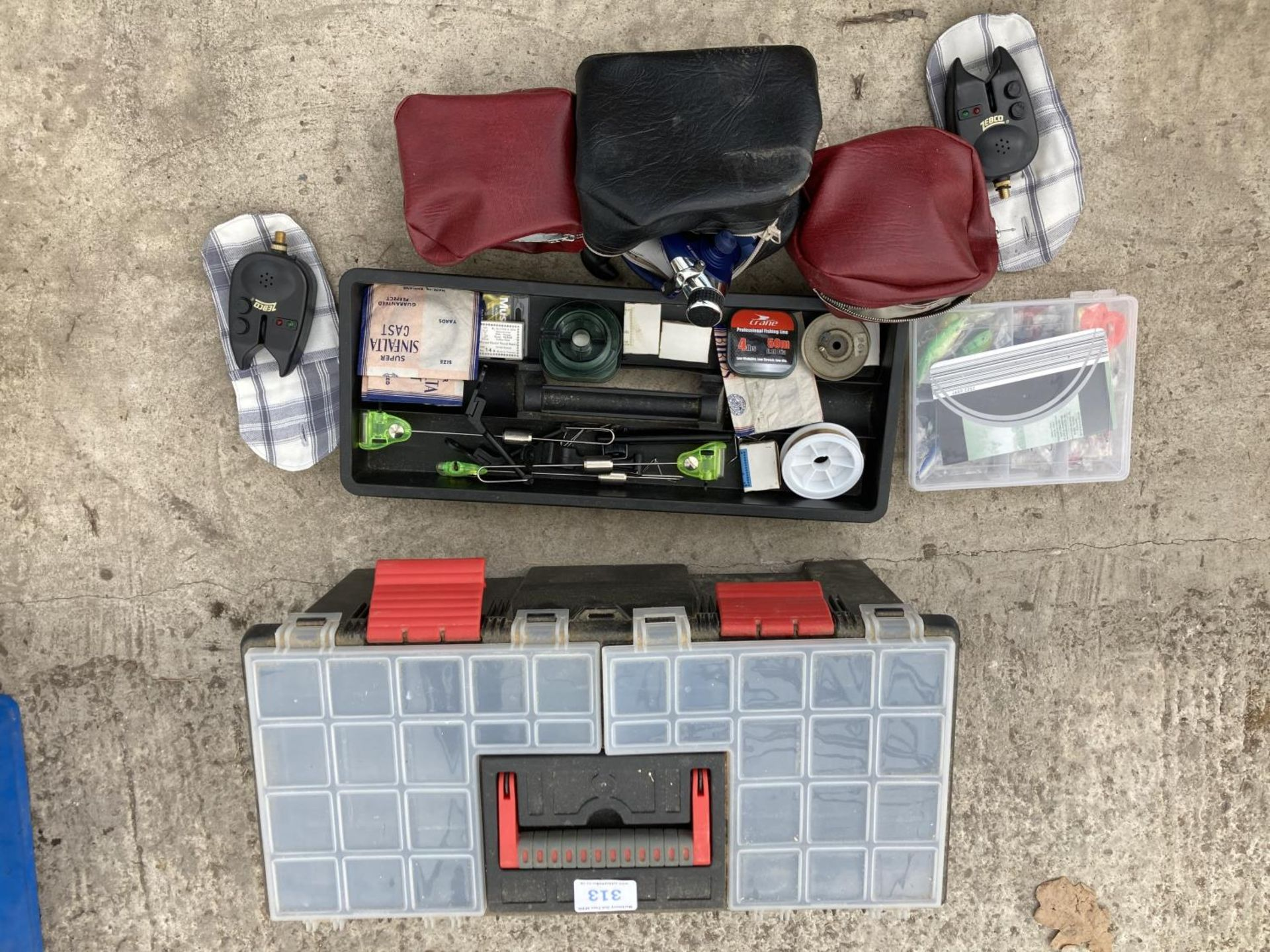 A TOOL BOX CONTAINING FISHING TACKLE TO INCLUDE RODS, ALARM, REELS ETC NO VAT