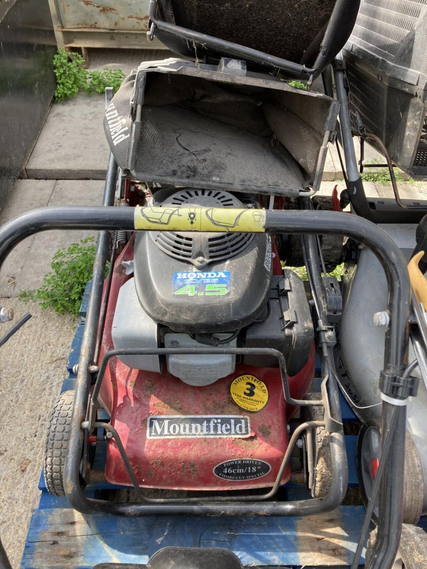 FOUR LAWNMOWERS TO INCLUDE TWO MOUTFIELD, A TESCO AND A WOLF GT 20SP + VAT - Image 5 of 5