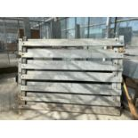 A PAIR OF ALUMINUM GATES OFF A CATTLE CONTAINER + VAT