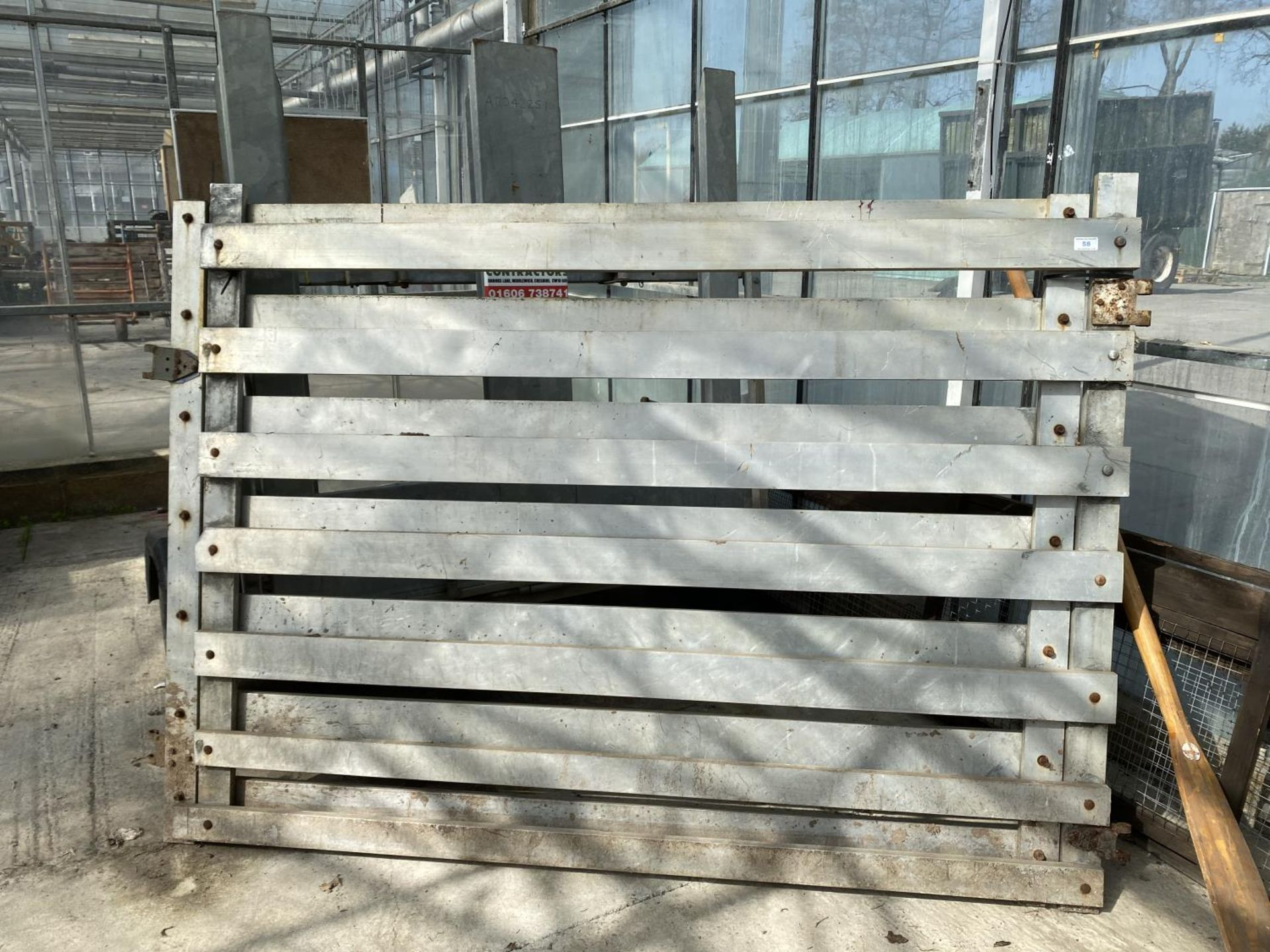 A PAIR OF ALUMIMIUM GATES OFF A CATTLE CONTAINER + VAT
