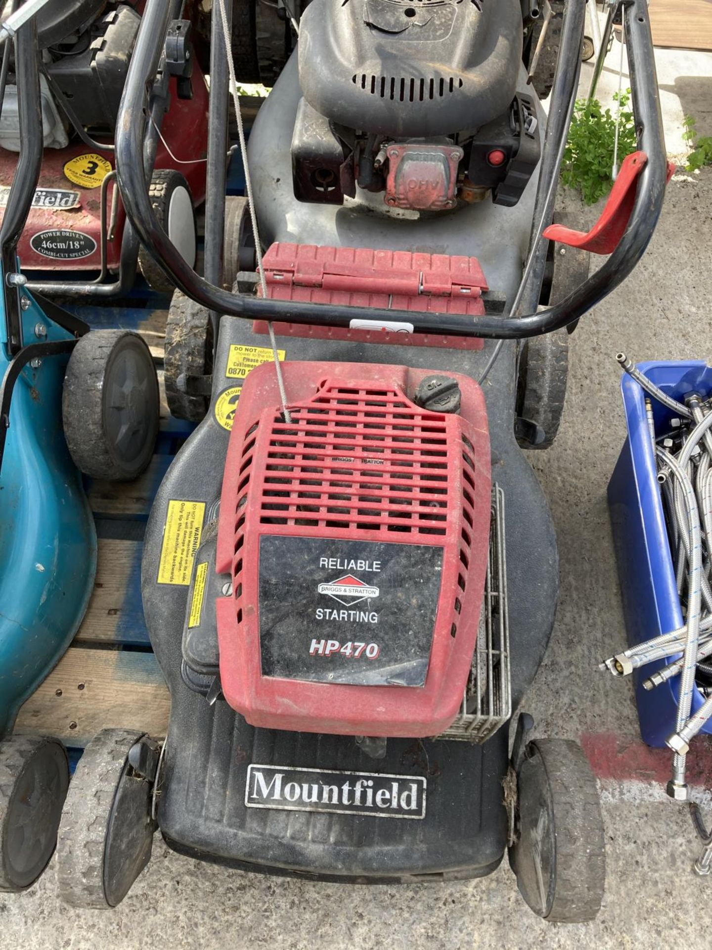FOUR LAWNMOWERS TO INCLUDE TWO MOUTFIELD, A TESCO AND A WOLF GT 20SP + VAT - Image 3 of 5