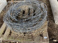 A QUANTITY OF BARBED WIRE