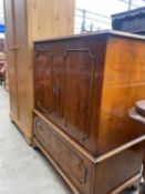 """A YEW WOOD CROSS BANDED TV/VIDEO CABINET ON BRACKLY FEET 34"""" WIDE"""