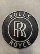 A CIRCULAR CAST METAL ROLLS ROYCE SIGN 24CM