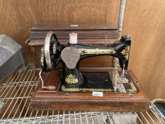 A VINTAGE SINGER SEWING MACHINE WITH WOODEN CARRY CASE AND KEY
