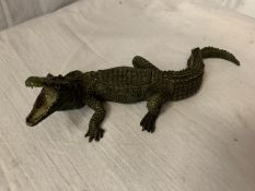 A FRANZ BERGMAN STYLE COLD PAINTED BRONZE CROCODILE WITH A REMOVABLE AND A CURLED UP LADY INSIDE