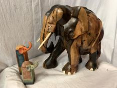 A LARGE CARVED HEAVY HARD WOOD ELEPHANT (H: APPROX. 30CM) AND TWO CERAMIC ELEPHANT ITEMS