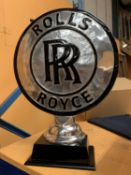 A CHROME ROLLS ROYCE SIGN ON A WOODEN BASE H: 50CM