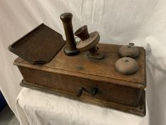 A VINTAGE TELEPHONE WITH DAFFODIL HANDSET AND METAL DOMED BELLS IN AN OAK WALL CASE