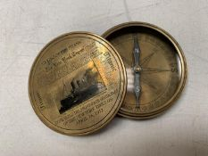 A BRASS COMPASS WITH ENGRAVING RELATING TO THE TITANIC
