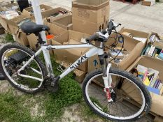 A MTKAX MOUNTIAN BIKE WITH FRONT SUSPENSION AND 27 SPEED GEAR SYSTEM