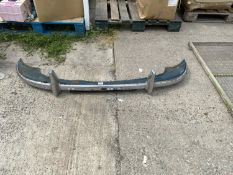 A CHROME CAR BUMPER BELIEVED TO BE FROM A MORRIS MINOR