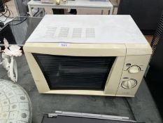 A WHITE MICROWAVE OVEN