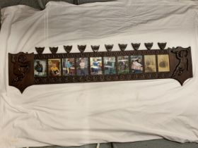 A VICTORIAN ORNATE WOODEN TEN PHOTO FRAME PANEL