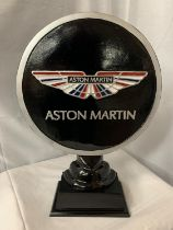 A LARGE ASTON MARTIN SIGN ON A WOODEN PLINTH H: APPROXIMATELY 52CM
