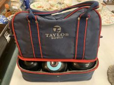 A PAIR OF THOMAS TAYLOR BOWLS AND A JACK BY THE SAME TO INCLUDE A CANVAS CARRY BAG