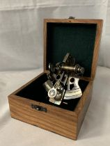 A BOXED BRASS SEXTANT