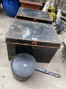 A PAIR OF METAL DEED TINS AND A CAST PAN